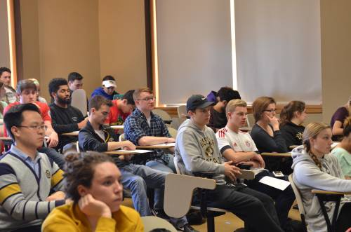 Students of the professional development course listen and interact with the panelists. Photo by Max Goldner.
