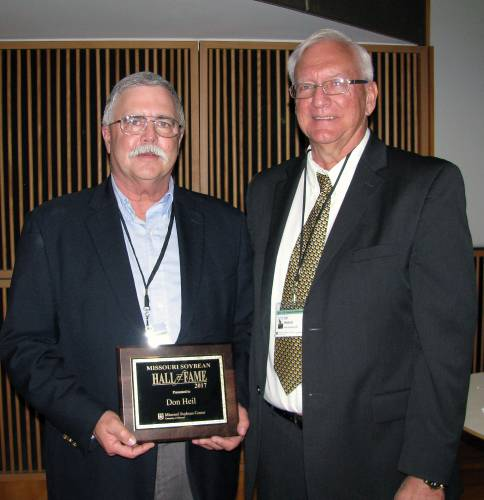 David Durham, left, received the plaque for the Don Heil family, from Bill Wiebold, MU Extension soybean specialist and director of Missouri Soybean Center. The late Don Heil was named the first inductee in the Soybean Hall of Fame at the U.S. Soybean Symposium on April 5.