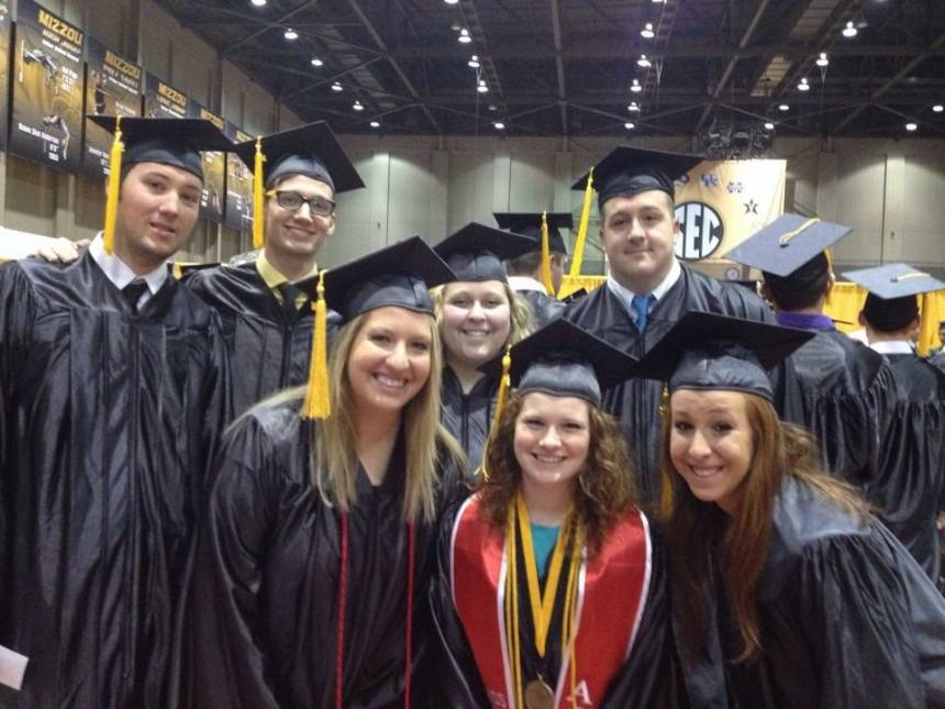 Higgins , front center, is joined by her food and beverage management classmates on graduation day in May of 2014.