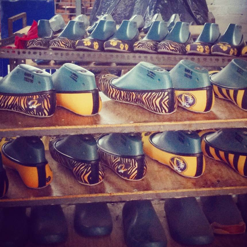 While in El Salvador, Link assisted in making customized Mizzou shoes that were sold in Columbia.