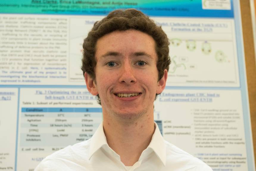 "AlexClarke won the ""Most ImportENTH Poster Award"" in the research poster session at Missouri Life Sciences Week 2017. Photo by Jinghong Chen courtesy of Bond Life Science Center."