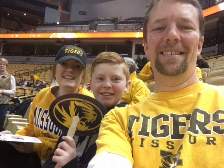 Morgan Bond, Braden Bond, and Dennis Bond cheering on the Tigers at the Hearnes Center.