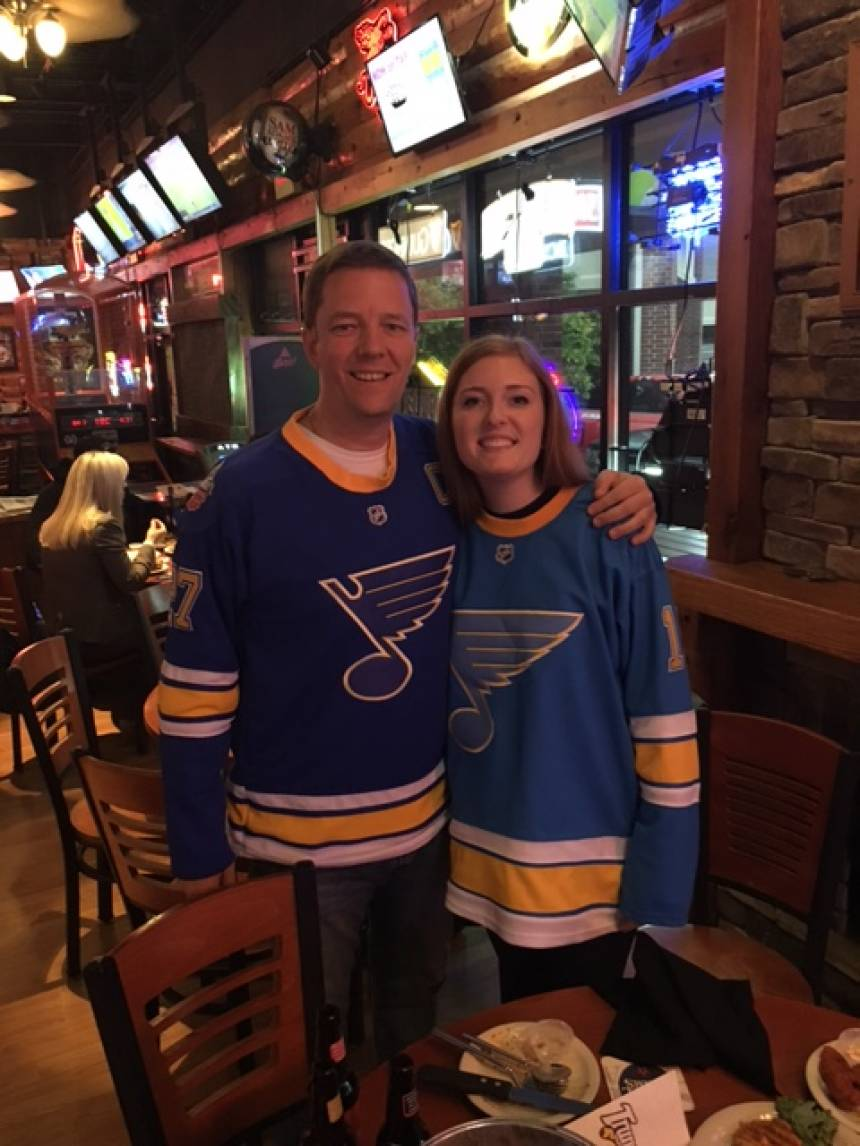 Dennis and Morgan sporting their St. Louis Blues jerseys.