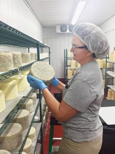 Customers can watch cheese being made through glass windows at Edgewood Creamery. The creamery uses 10 percent of the dairy's milk.
