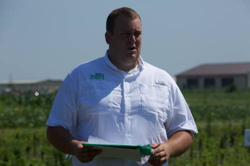 Graduate student Eric Oseland presents his research during the Pest Management field day in July.