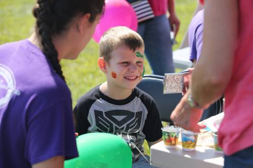 The Southwest Research Center field day featured several activities for children, including a face painting station.