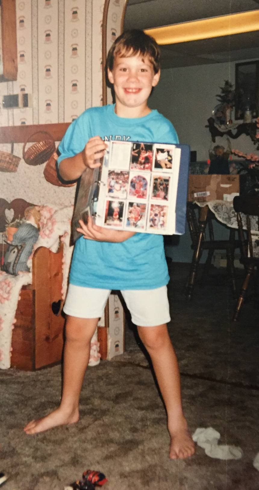 A childhood Logan displaying his early card collection.