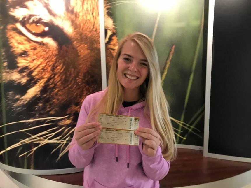 Kendra Elder w homecoming tickets won at bonfire
