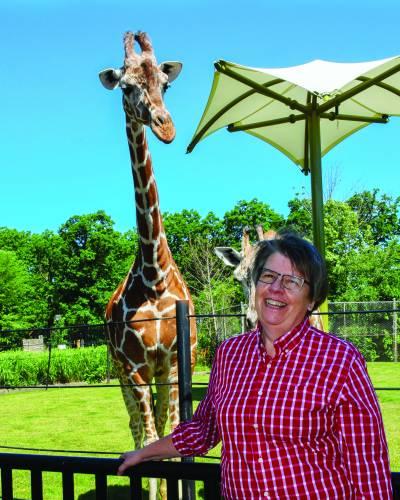 Norah Fletchall with a giraffe.