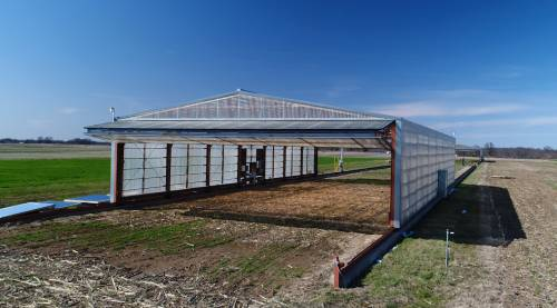 The rainout shelters have an automated system that senses if it's raining. The shelters move over the crops as soon as they sense rain. There are three sections of the shelter that represent three fields. Thompson said that when she designs an experiment, the north and south sections are used. The center section is the parking zone for the shelters.