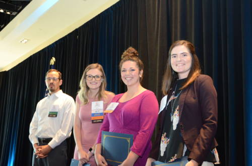 Alexa Nordwald accepts the American Agricultural Editors Association (AAEA) Jim Evans Presidential Scholarship at this summer's Agricultural Media Summit.