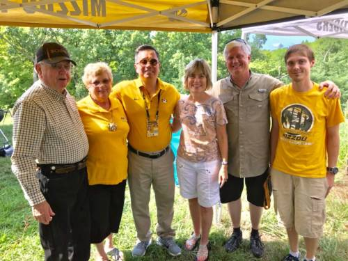 UM System President Mun Choi stopped by the tailgate to visit with the entire crew earlier this year. Choi is pictured with the Garton family. Photo courtesy Bryan Garton.