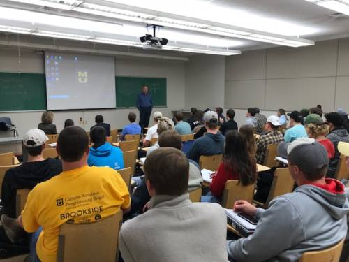 Craig Bacon teaches a class.
