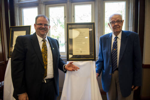 Mel West, pictured with MU Chancellor Alexander Cartwright. Photo courtesy University of Missouri.
