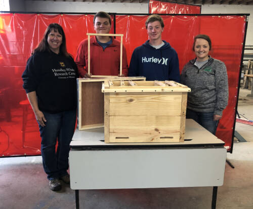 Jennifer Miller (left) worked with Albany High School students to create a horizontal hive for the Hundley-Whaley Research Center.