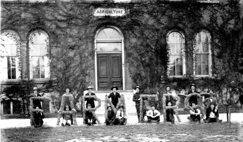 Vintage photo of people holding FARMERS letters