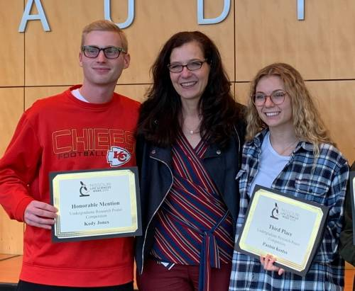 Kody Jones, left, with Dr. Antje Heese, middle, and Paxton Kostos, right. Both students conduct research in Dr. Heese's lab. Jones said he couldn't believe two students from Dr. Heese's lab were among the 15 recipients who received this award.