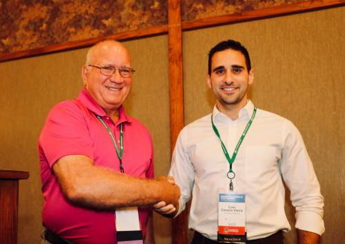 Caio Canella Vieira (right) is pictured here with Donn Cummings, former chair of the NAPB Borlaug Program, during the NAPB awards ceremony last year, where Canella Vieira received the Borlaug scholarship and first place in the research competition. Photo courtesy of Caio Canella Vieira.