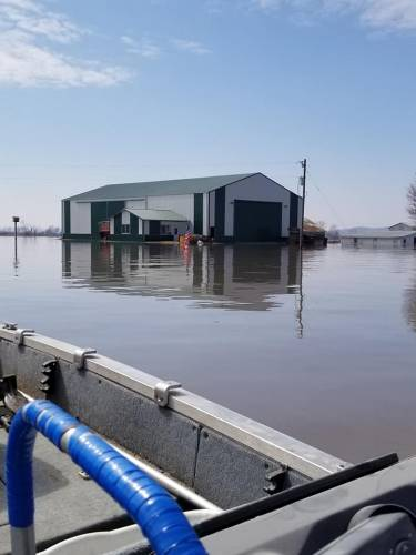 Jim Crawford assisting Missourians during the flood of 2019 via boat.
