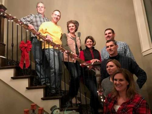 Fisher (pictured at the top of the stairs) is the oldest of eight children -- and all seven of his siblings have been connected to CAFNR at some point in their college careers or lives. Photo courtesy of John Fisher.
